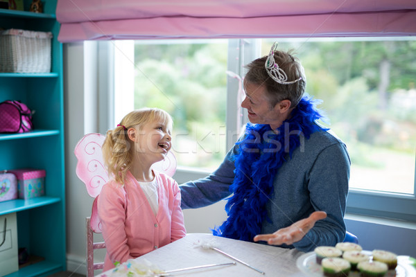 Girl pretending to be a fairy playing with her father Stock photo © wavebreak_media