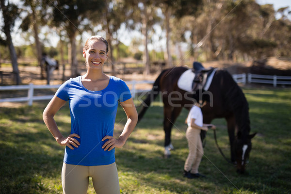 Portrait of female jockey with sister by horse in background Stock photo © wavebreak_media