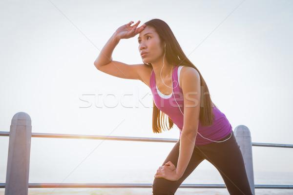Sweating fit woman resting at promenade Stock photo © wavebreak_media