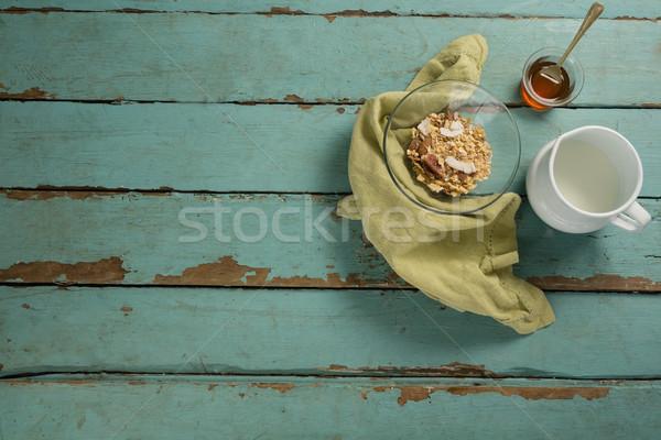 чаши сухих завтраков меда молоко деревянный стол древесины Сток-фото © wavebreak_media