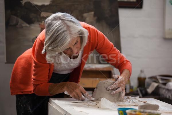 Attentif supérieurs femme argile dessin classe Photo stock © wavebreak_media