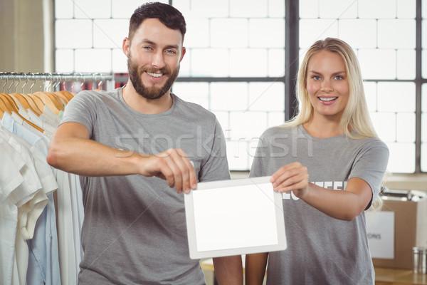 Mosolyog önkéntesek tart digitális tabletta iroda Stock fotó © wavebreak_media