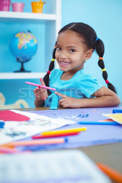 небольшой девушки рисунок фотография столе счастливым Сток-фото © wavebreak_media