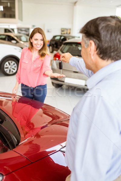 Smiling businessman giving car key to happy customer Stock photo © wavebreak_media