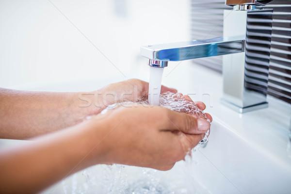 Woman washing her hands Stock photo © wavebreak_media