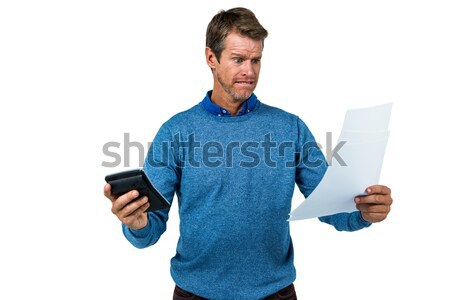 Young man holding disposable cup and reading newspaper Stock photo © wavebreak_media