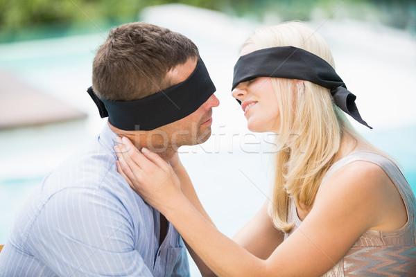 Blindfolded couple kissing  Stock photo © wavebreak_media