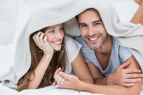 Stock photo: Happy couple enjoying under blanket