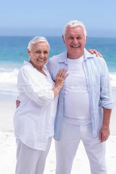 Senior couple smiling and looking the camera Stock photo © wavebreak_media