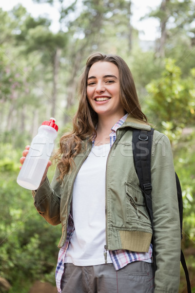 Stock photo: Woman drinking water with backpack