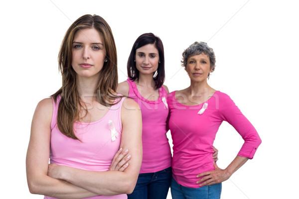 Kobiet różowy stwarzające rak piersi świadomość biały Zdjęcia stock © wavebreak_media
