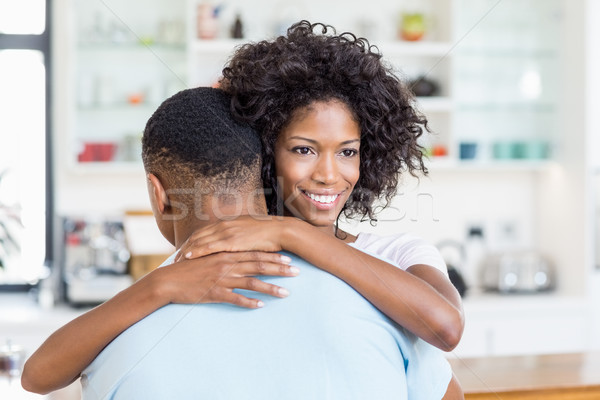 Young couple embracing in kitchen Stock photo © wavebreak_media