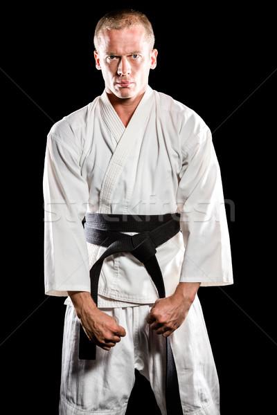Vadászrepülő előad karate hozzáállás portré fekete Stock fotó © wavebreak_media