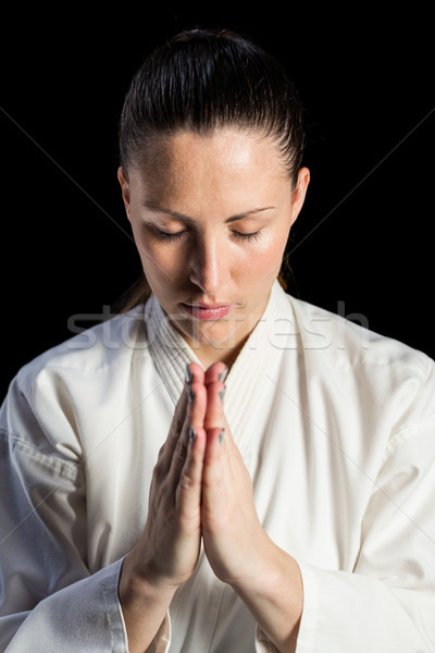 Close-up of female karate fighter meditating Stock photo © wavebreak_media