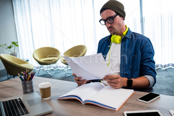 Hipster looking at a document Stock photo © wavebreak_media