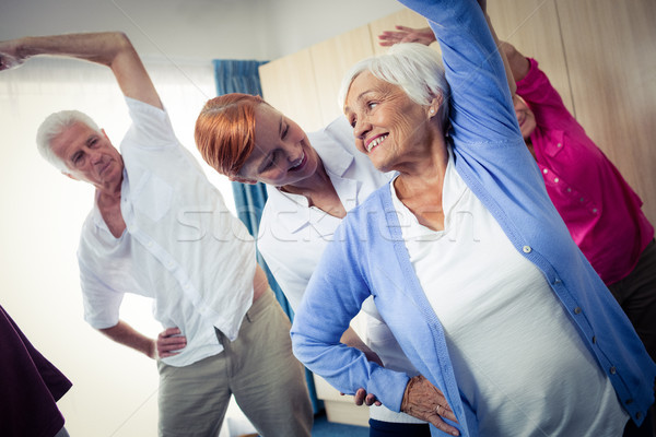 Group of seniors doing exercises with nurse Stock photo © wavebreak_media