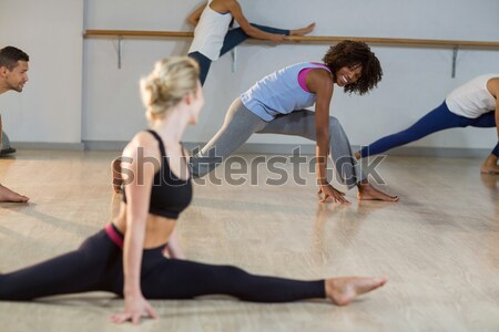 Woman performing stretching exercise Stock photo © wavebreak_media
