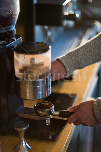 Waiter holding portafilter filled with ground coffee Stock photo © wavebreak_media