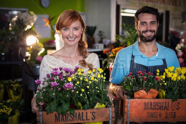 Portrait of couple holding crate of flower bouquet Stock photo © wavebreak_media