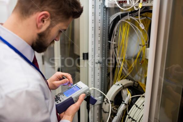 Technician using digital cable analyzer Stock photo © wavebreak_media