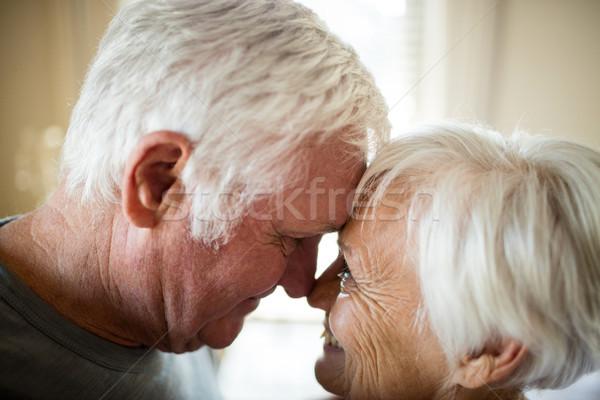 Pareja de ancianos dormitorio casa mujer ancianos sonriendo Foto stock © wavebreak_media