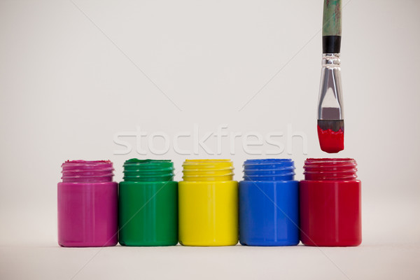 Watercolor paints and paint brush with red paint dipped into red color Stock photo © wavebreak_media