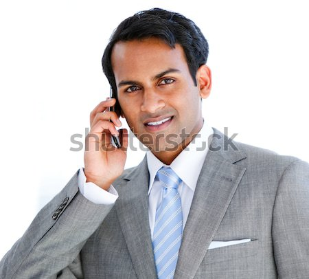 Positive businessman taking a phone call  Stock photo © wavebreak_media