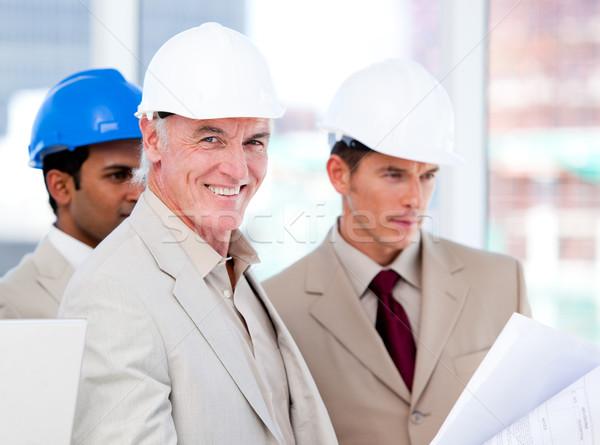 Glimlachend architect team werken gebouw project Stockfoto © wavebreak_media
