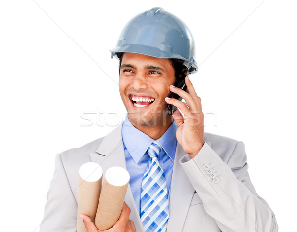Confident businessman wearing a hardhat on phone Stock photo © wavebreak_media