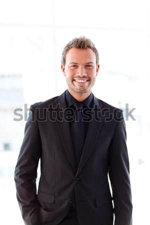 Self-assured businessman standing with folded arms  Stock photo © wavebreak_media