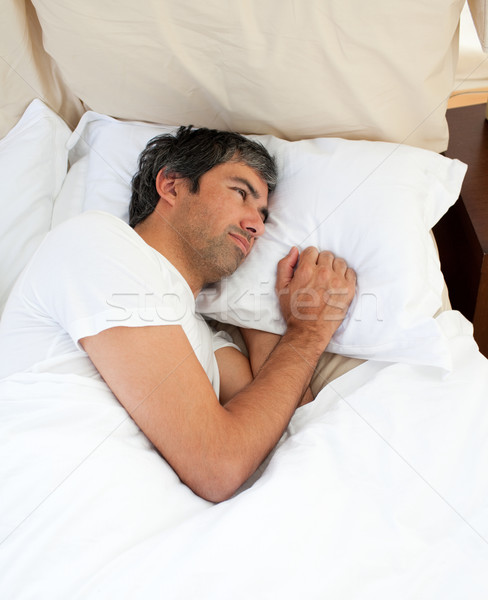 Pensativo homem argumento cama casa casal Foto stock © wavebreak_media