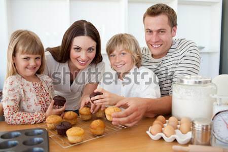 Loving family eating their muffins Stock photo © wavebreak_media