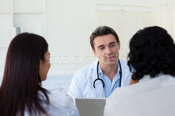Male doctor explaining diagnosis to a couple Stock photo © wavebreak_media
