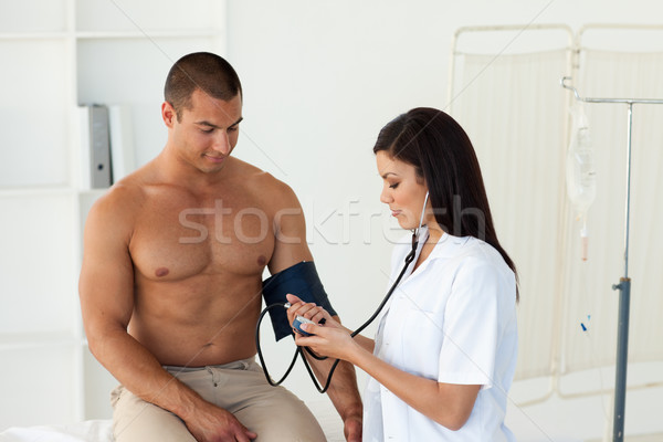 Femminile medico pressione sanguigna paziente ospedale sangue Foto d'archivio © wavebreak_media