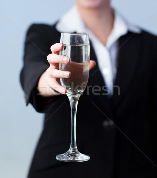 Mulher de negócios champanhe vidro câmera foco Foto stock © wavebreak_media