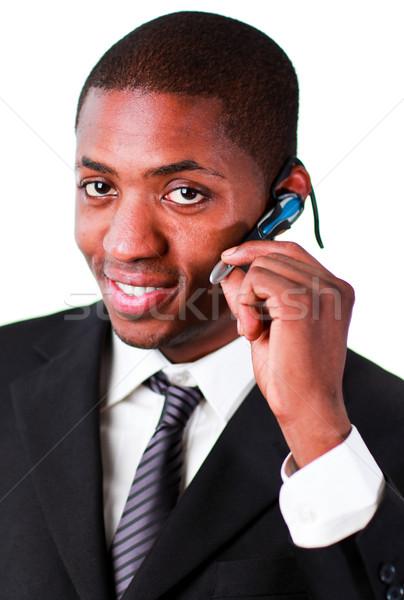 Businessman wearing an earpiece Stock photo © wavebreak_media