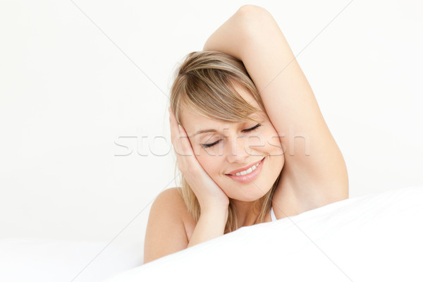 Portrait of a charming woman waking up  Stock photo © wavebreak_media