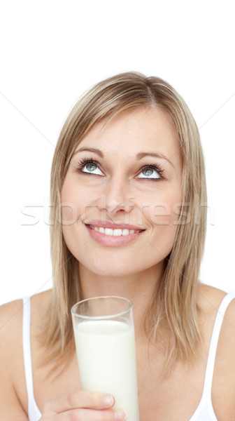 Delighted woman holding a glass of milk  Stock photo © wavebreak_media