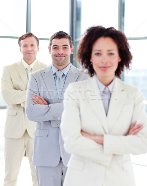 Stock photo: Attractive businessman with folded arms in a row