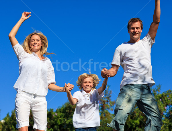 Lively family jumping in the air Stock photo © wavebreak_media