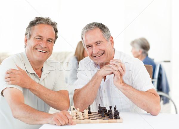 Hombres mirando cámara hablar hombre feliz Foto stock © wavebreak_media