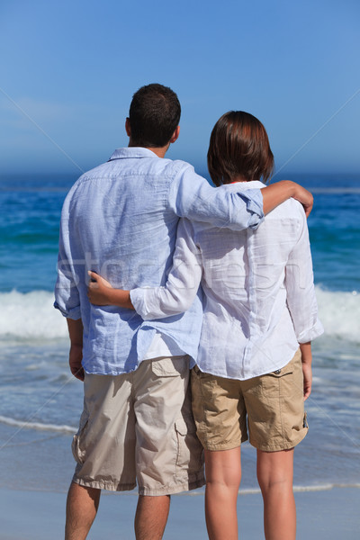 Enamored couple looking at the sea Stock photo © wavebreak_media