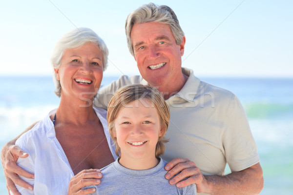 Grands-parents petit-fils plage ciel eau sourire Photo stock © wavebreak_media