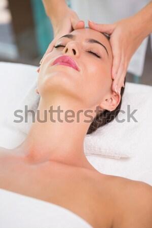 dark-haired woman having a forehead massage smilling Stock photo © wavebreak_media