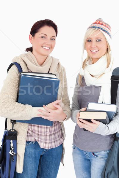 Kettő szép női diákok könyvek néz Stock fotó © wavebreak_media