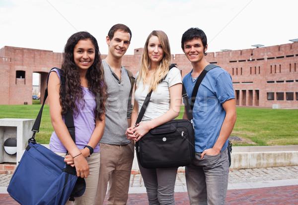 Fellow students posing outside a building Stock photo © wavebreak_media