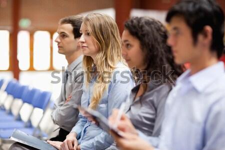 деловая женщина улыбаясь камеры презентация бизнеса бумаги Сток-фото © wavebreak_media
