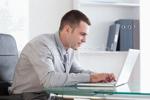 Young businessman working concentrated on his laptop Stock photo © wavebreak_media