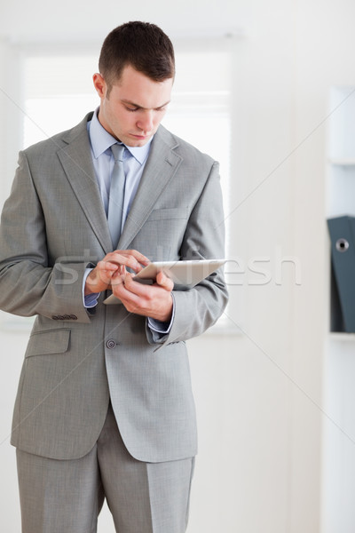 Businessman having a careful look at his notes Stock photo © wavebreak_media