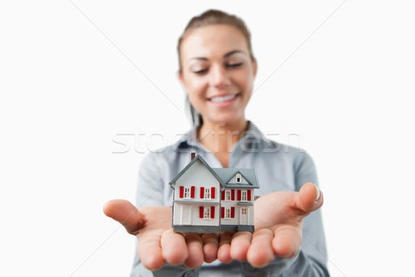 Miniatűr ház fiatal női ingatlanügynök fehér Stock fotó © wavebreak_media
